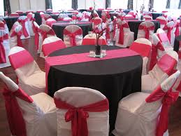 Black tablecloths, white custom chair covers, hot pink / fuchsia runners  and chair ties. Beautiful tables and beautiful wedding!