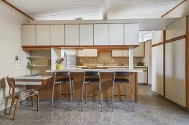 the open kitchen features ample storage and a breakfast bar