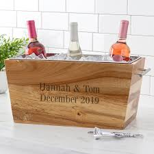 acacia wood beverage trough chiller holding 3 wine bottles end with names and date