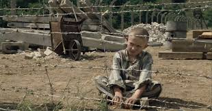 the boy in the striped pajamas that boy is shmuel he is also wearing pajamas and has a shaved head