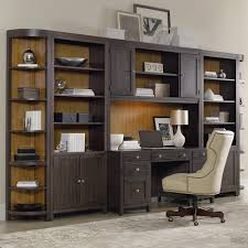 dark wood finish wall shelving unit with table and cabinetry and small dark wood cabinet