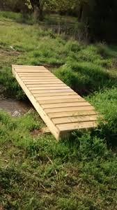 11 foot long walk bridge across pond drainage