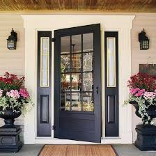farmhouse style front doorsBlack Farmhouse Style Front Door  With log home and red trim