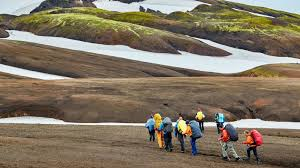 hikers in the mountains of landmannalaugar
