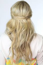 half up half down hairstyles wedding. speaking of braids, these two fishtail braids crisscrossed at the back make this style ideal for a casual, beachy wedding. half up down hairstyles wedding y