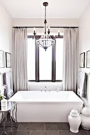 beaded paris flea market chandelier over rectangular bathtub view full size
