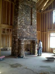 Attractive Tall Indoor Stone Fireplace For House Decoration In Visible Beam  Ceiling Design Ideas