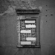 old building brick wall with window black and white stock photo