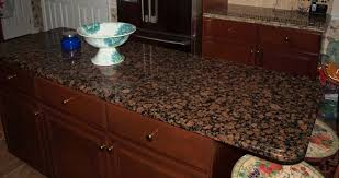 this beautiful island countertop was done in the color baltic brown granite