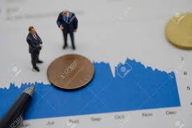 Dollar Coin Value Chart Top View Of Miniature Business Men On Capital Chart And Us Dollar