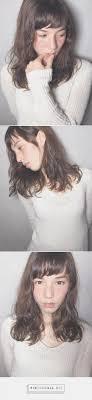 ミディアムショートバングと外国人風ウェーブパーマblessの髪型ヘア