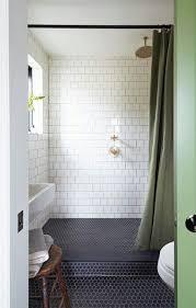 navy hex tiles on the shower and bathroom floor