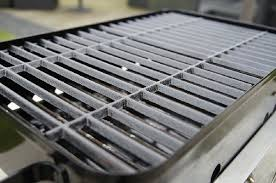 cast iron vs snless steel grill