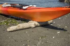 kayak resting on log