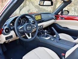 when equipped with grand touring trim the mx 5 miata rf includes leather seats automatic climate control and a full complement of mazda connect