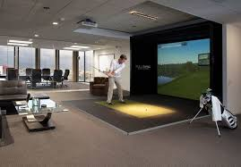 best home golf simulator. Man Practicing Golf At Home With The Simulator Best