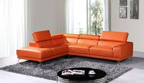 orange leather couch ikea shaped black carpet white wall round table sectional beige sofa patio furniture