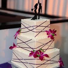 Classy Modern Wedding Cake With Purple And Rhinestone Ribbon And
