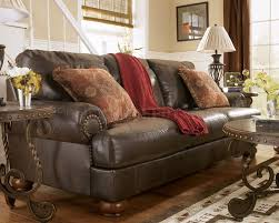 Rustic Living Room Set Truffle Color Rustic Living Room With Nailhead Deatils By Ashley 85601