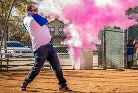 gender reveal baseball hitting