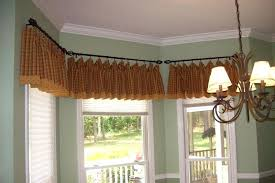 how to hang curtains in a bay window bay window curtain rods hang net curtains bay