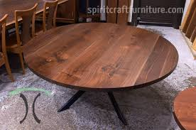 custom made solid wood round black walnut table top on welded steel table base handcrafted for