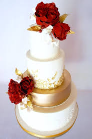 Red Flower Topped Gold And White Wedding Cake Wedding Cakes