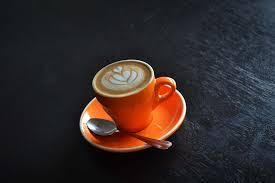 Espresso and steamed milk are a classic combination. Magic Coffee Ninja