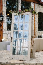 Rustic And Vintage Inspired Door With Seating Chart Written