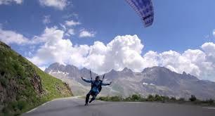 man performs breathtaking paragliding