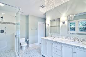 spa like master bath with glass chandelier and pedestal tub traditional bathroom
