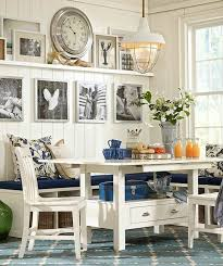coastal dining room. Coastal Dining Space With Bench Seating And White Chairs To Compliment The Neautral Palette Room