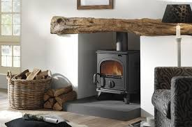 black cast iron stove in fireplace with oak beam dru 44 wood burning