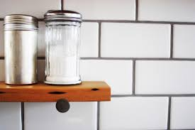 reclaimed wood shelf with subway tile