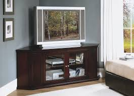 furniture corner brown varnished wooden tv cabinet with glass door on laminate flooring and grey