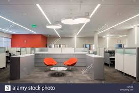 open office architecture images space. Delighful Office An Open Office Space With Creative Lighting A Lobby Chairs Desks  And Cubicle Walls Large White Suspended Lights Inside Open Office Architecture Images Space N