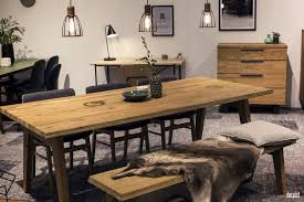stylish modern dining room wooden table bench and drawers gray rugs black pendant lights and desk lamp