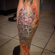 струны гитары в огне тату на голени у парня добавлено иван