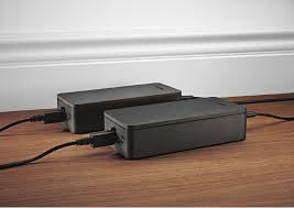 bose 650. you can connect the rear speakers by wire. if do so, will not need power supplies that are used during a wireless application. bose 650