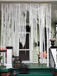 love halloween window decor: make ghostly outdoor draperies for halloween