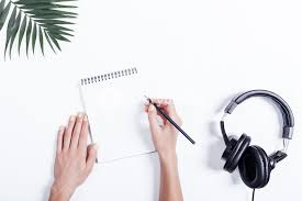 White table top view Office Desk Work Female Hands With Notebook And Pencil Headphones And Plant On White Table Top Storyblocks Female Hands With Notebook And Pencil Headphones And Plant On