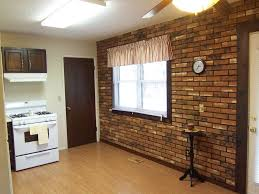 interior old brick wall decor for dining room with wooden dining table also black ironc