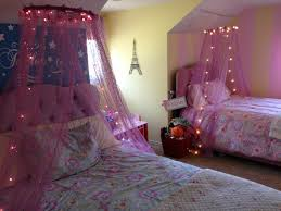bedrooms for girls purple and pink. charming little girl canopy bed with high pink tufted headboard also sheer purple netting sparkling light decor over floral sheet bedrooms for girls and
