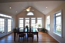 vaulted ceiling lighting dining room with recessed lights and ceiling lighted fan vaulted