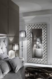 The Large Modern Button Upholstered Nubuck Leather Wall Mirror is striking.  A hand-crafted