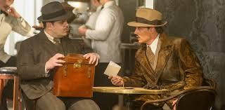 josh gad left and johnny depp star in twentieth century fox s on