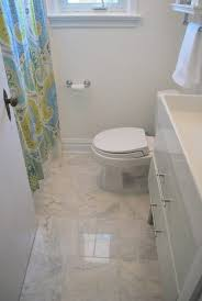 so when i went out tile ping and found some huge square tiles that were ceramic carrara marble lookalikes on a i was sold