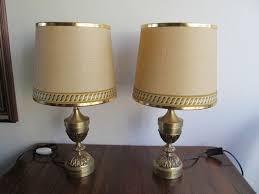 pair of brass table lamps vase shaped empire style approx 1960