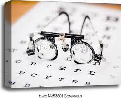 Eye Chart Machine Eye Test Glasses On Snellen Chart Canvas Print