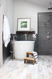 This bathroom by Design Indulgence incorporates a Japanese soaking tub in a  corner, and fits
